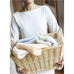 woman carrying a basket of laundry