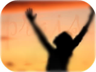 woman with arms raised worshipping God